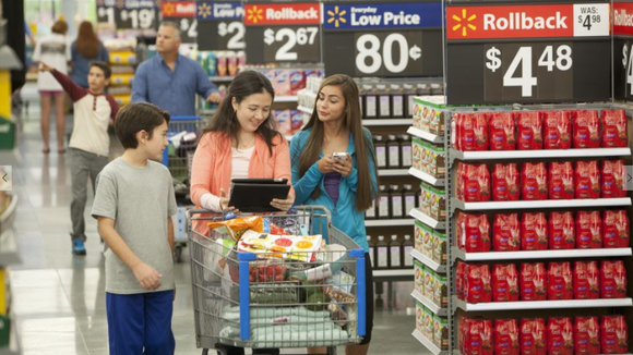Shoppers browsing  Wal-Mart aisle.