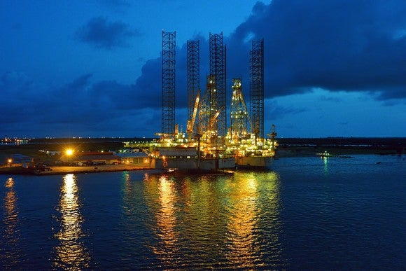 Offshore oil rig in dock at night