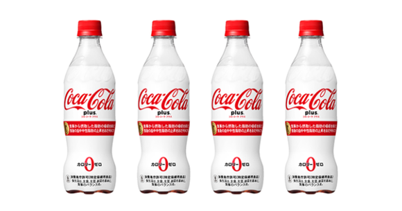 """Line of four """"Coca-Cola Plus"""" white and red Japanese beverage bottles."""