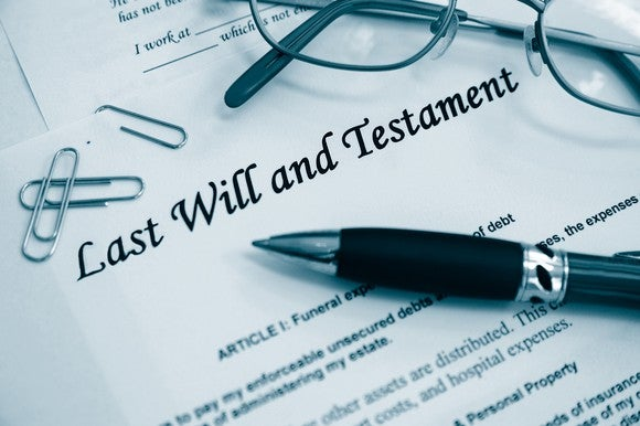 Last will and testament document with pen and eyeglasses on top of it
