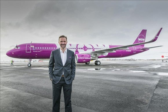 WOW Air founder Skuli Mogensen standing in front of a WOW Air plane