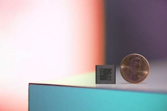 A Snapdragon 835 compared to a penny.