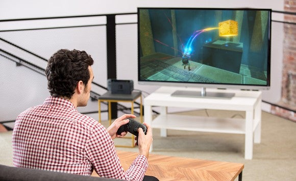 A man playing a game on the Nintendo Switch.