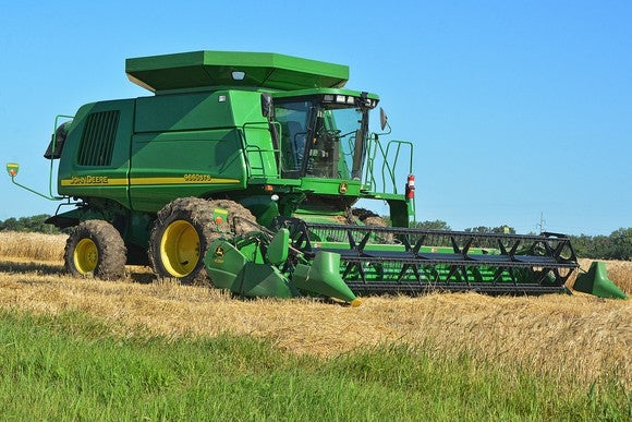 a Deere combine harvester in a field.