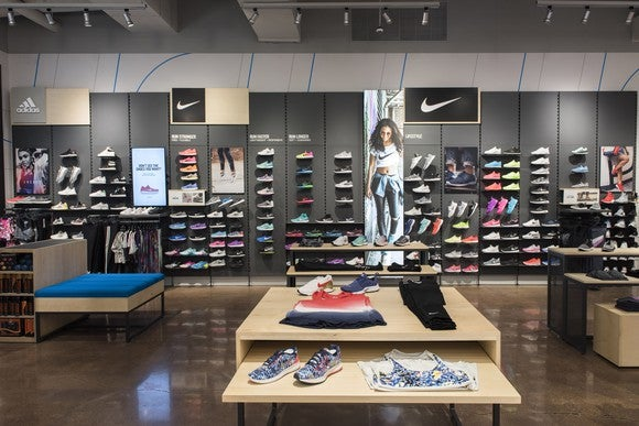 Finish Line store interior with neatly organized shoes on wall display