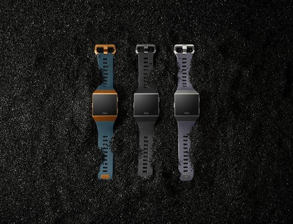 3 Fitbit Ionic smartwatches on a gravel background