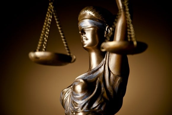 A statue of justice blindfolded and holding scales in her hand.