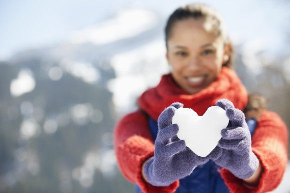 Woman with heart made of snow