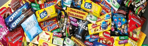 A pile of assorted snacks and candies sold by Mondelez