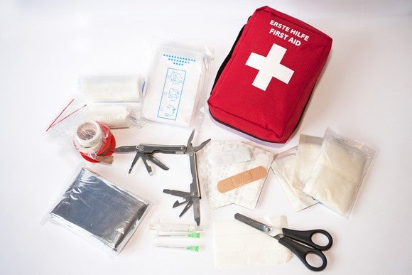 A first-aid kit is laid out.