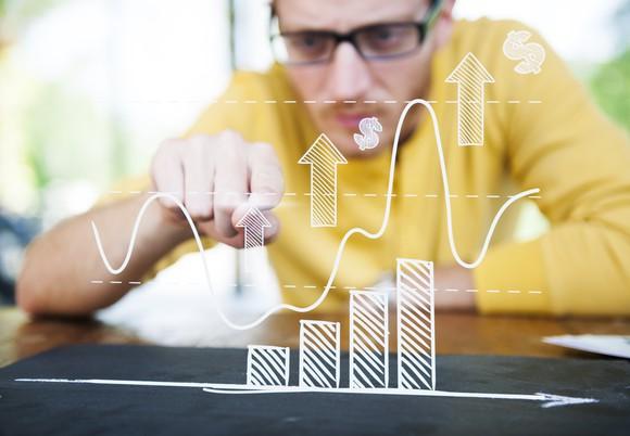 A man studying a graph