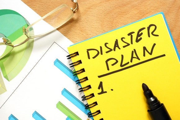 "notepad with words ""disaster plan"" written on it"