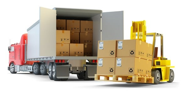 Large boxes on pallets being offload from a truck