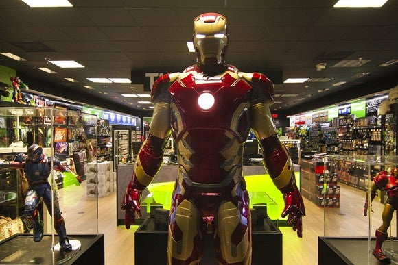 An Iron Man statue and other merchandise in a ThinkGeek location.