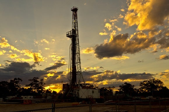 A land drilling rig at sunset.
