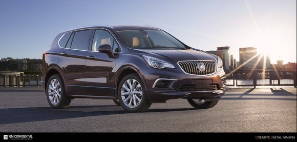 A 2017 Buick Envision with a skyline and sunset in the background.