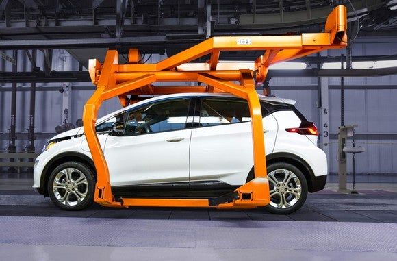 A white preproduction Chevrolet Bolt EV is shown on the assembly line at GM's factory in Orion Township, Michigan last year.