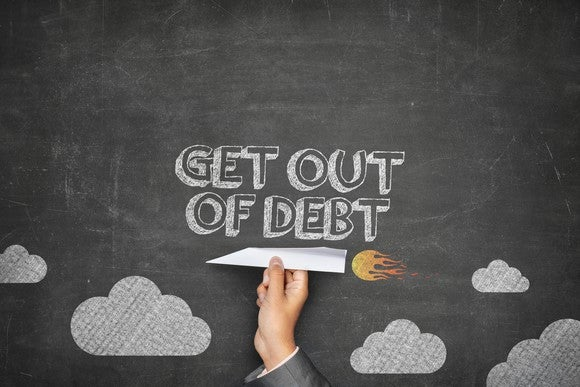 """Get out of debt"" on a chalkboard"