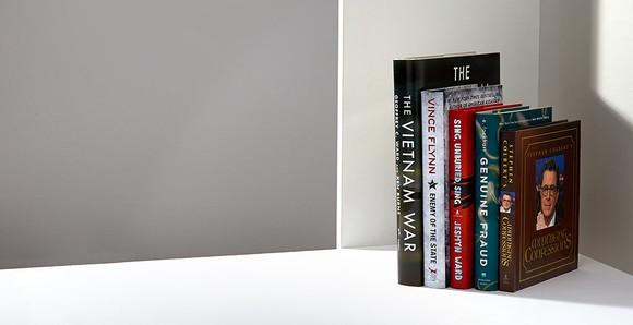 Several books in the corner of a bookshelf