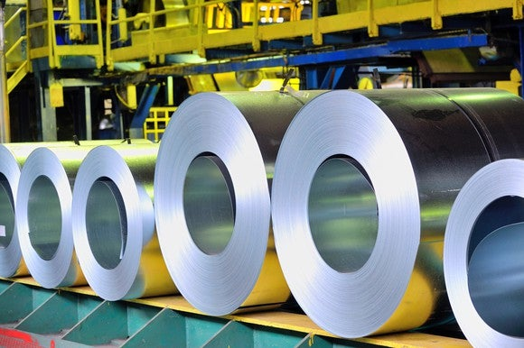 Rolls of metal in a factory.