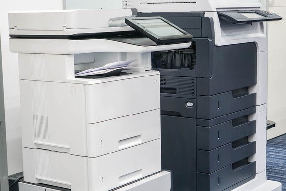 Two office-class printers, side by side.
