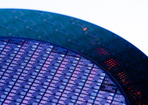 Semiconductor wafer circuit; detail of round wafer circuit in purple tones.