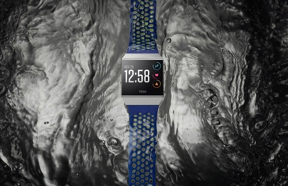 A smartwatch against a background suggesting water