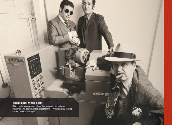Three people dressed in old-fashioned clothing next to a testing machine.