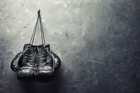 Boxing gloves hanging on a wall.