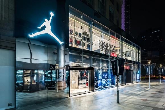 Michael Jordan's Jumpman Logo shines over a basketball court inside Nike's new Beijing store