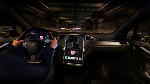 Tesla driver using Autopilot.