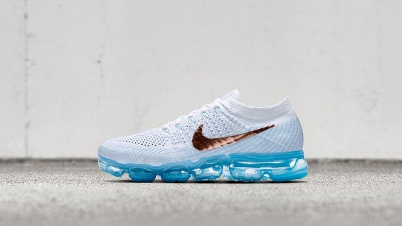 Nike Air VaporMax running show in white with translucent blue colored sole.