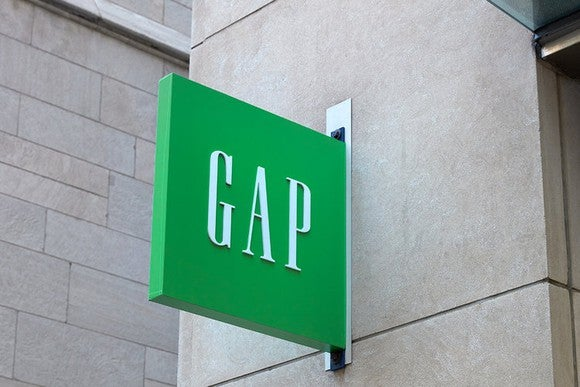 "A green ""Gap"" sign on a building"