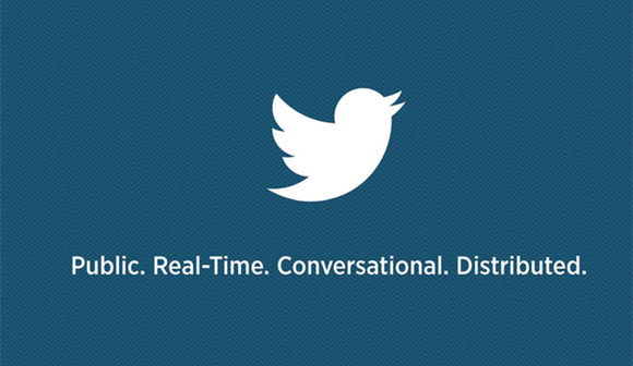 "White Twitter bird on a dark blue background, above this text in white: ""Public. Real-time. Conversational. Distributed."""