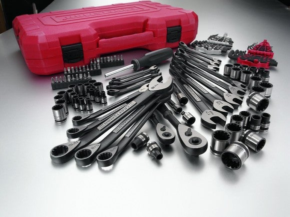 An array of Craftsman hand tools and a red toolbox.