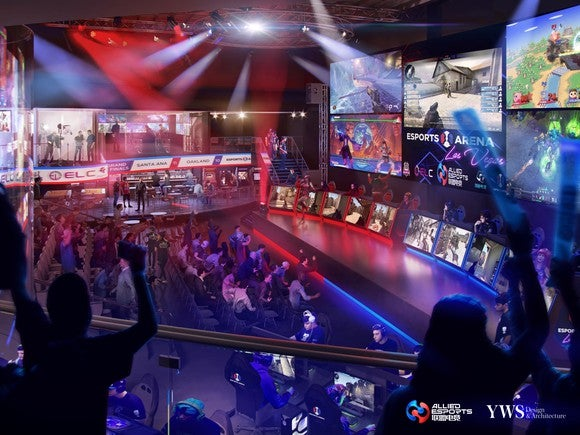 Rendering of MGM's esports arena with giant screens and seats for viewers.