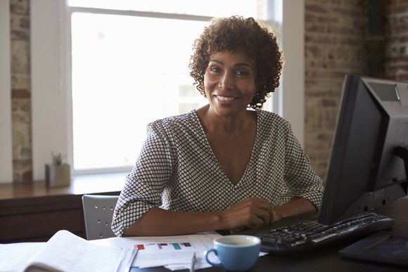 Woman at her computer, smiling