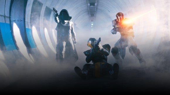 "Three characters from ""Destiny 2"" holding guns inside of a smoke-filled tunnel."