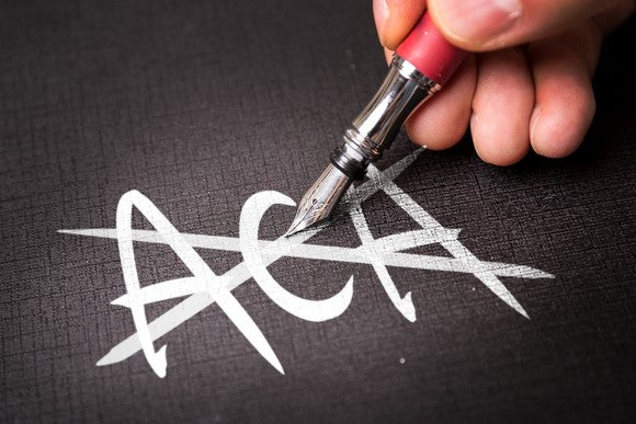 "The letters ""ACA"" crossed out by a fountain pen."