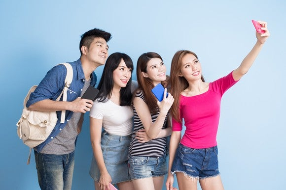A group of friends takes a selfie.