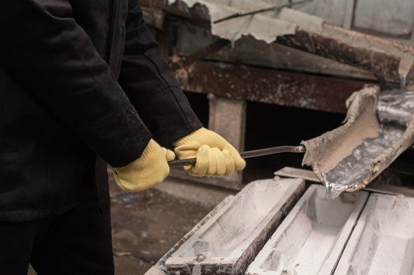 A sliver metal being poured into a mold