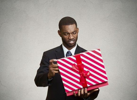 A man opening up a package