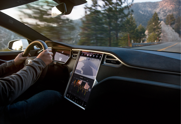 Tesla Model S interior, while driving in the mountains.