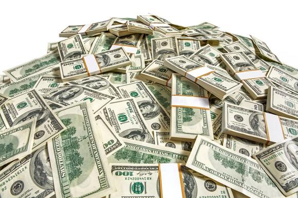 Pile of bundles of 100 dollar bills..