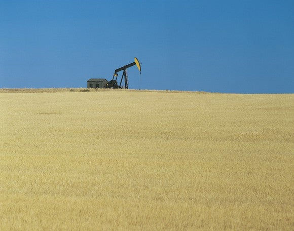 A lone oil pump in a field.