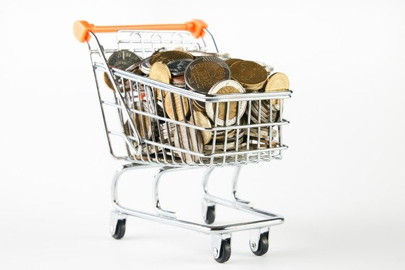 Shopping cart filled with coins.