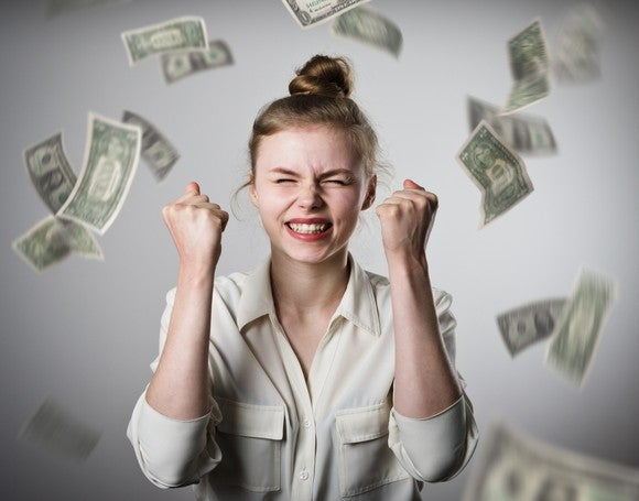 Money raining down on woman