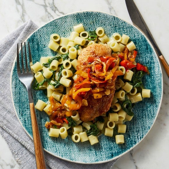 A plate of chicken and pasta