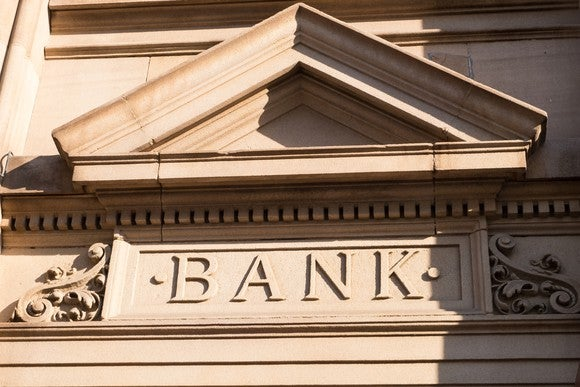 "Stone facade spelling out ""BANK"""
