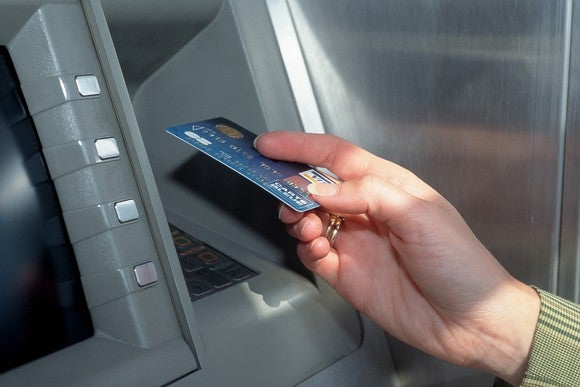 Payment card holder using an ATM